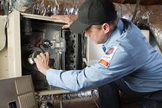 Repair Man fixing furnace
