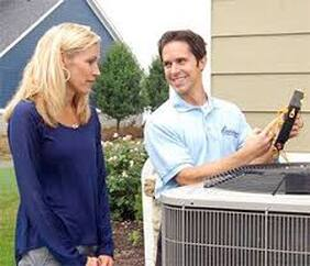 man fixing woman's air conditioner