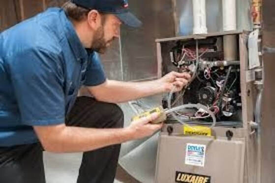 Repairman fixing furnace